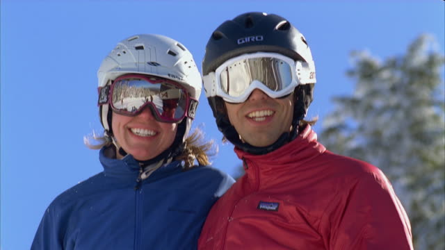 cu couple having fun and smiling in snow / rangeley, maine, usa - ski jacket stock videos and b-roll footage