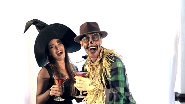 couple having fun at adult halloween costume party - stage costume stock videos & royalty-free footage