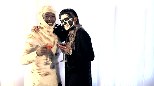 couple having fun at adult halloween costume party - pacific islander male stock videos & royalty-free footage