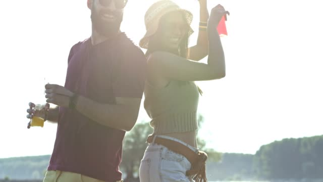 couple having fun at the beach - dancing back to back stock videos & royalty-free footage