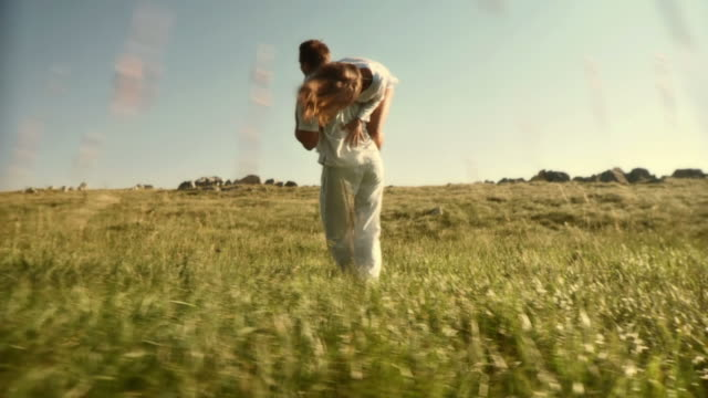 hd slow-motion: couple having fun in nature - falling in love stock videos & royalty-free footage