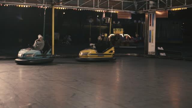 couple having fun in the city - riding bumper car - bumper car stock videos & royalty-free footage