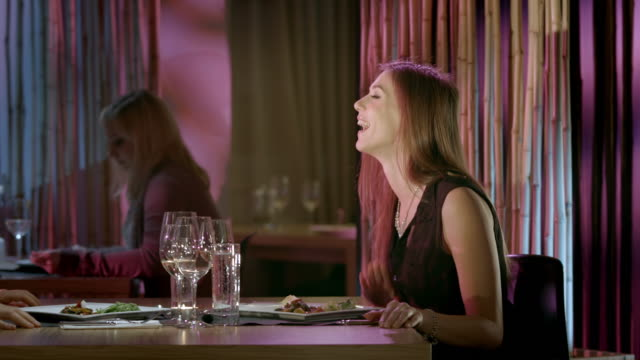 hd dolly: couple having fun in the restaurant - piano stock videos & royalty-free footage