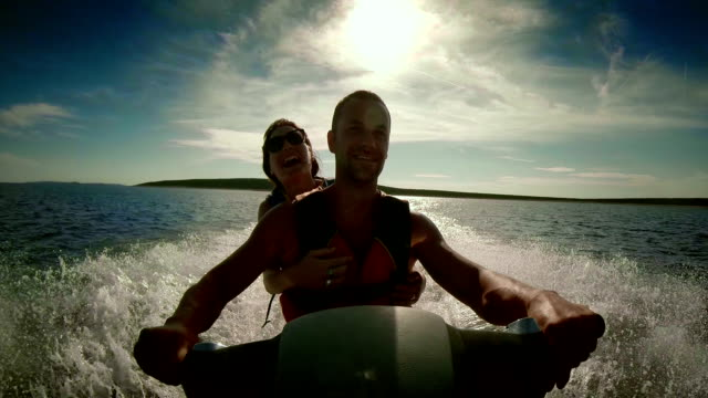 POV Couple Having Fun Riding A Jet Boat