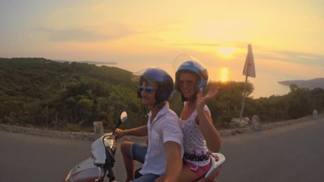 pov couple having fun riding a scooter - motor scooter stock videos & royalty-free footage