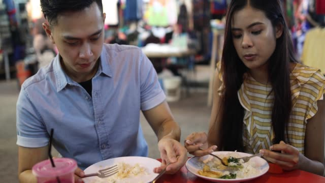 Couple Having Lunch At Chinese Restaurant