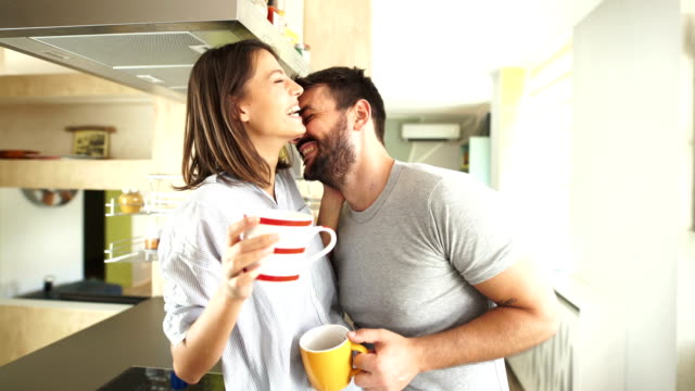 couple having morning coffee at home. - loving cup stock videos & royalty-free footage