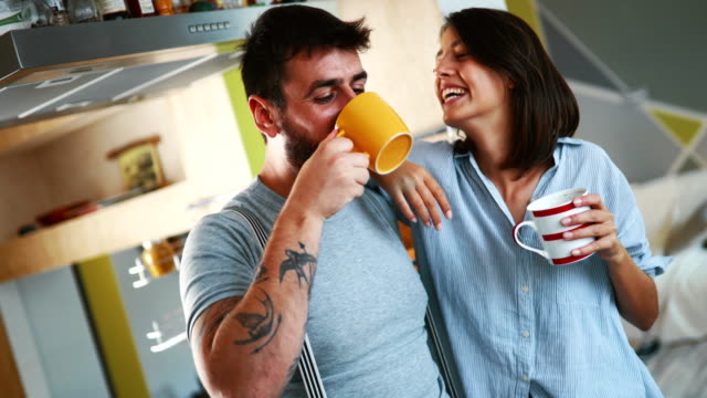 couple having morning coffee at home. - coffee drink stock videos & royalty-free footage