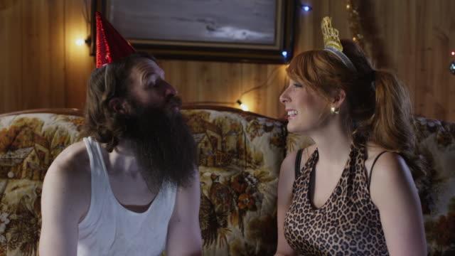 stockvideo's en b-roll-footage met ms couple having party in living room / orem, utah, usa - orem utah