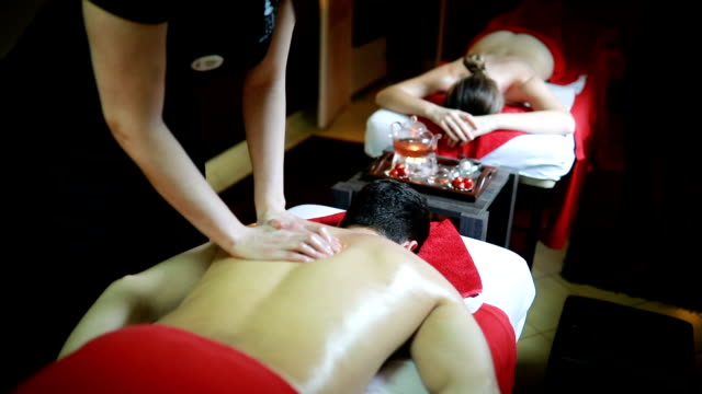 Couple having relaxing back massage at beauty spa