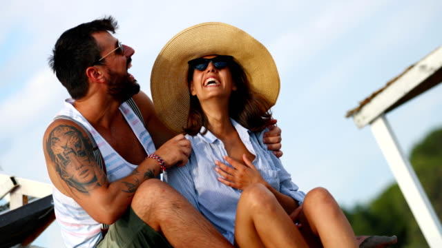 couple having romantic vacation. - sun hat stock videos & royalty-free footage