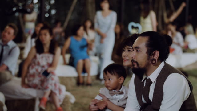 Couple having romatic moment with a movie at wedding party.