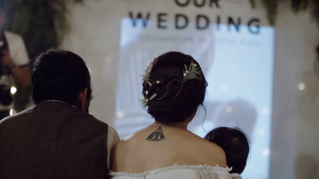 couple having romatic moment with a movie at wedding party. - projection equipment stock videos & royalty-free footage