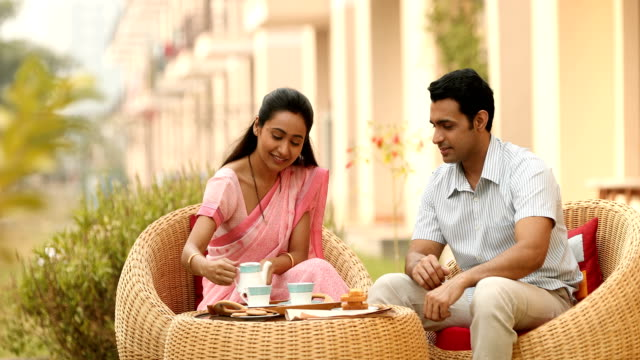 ms couple having tea outside house / sonipat, haryana, india - indian couple tea stock videos & royalty-free footage