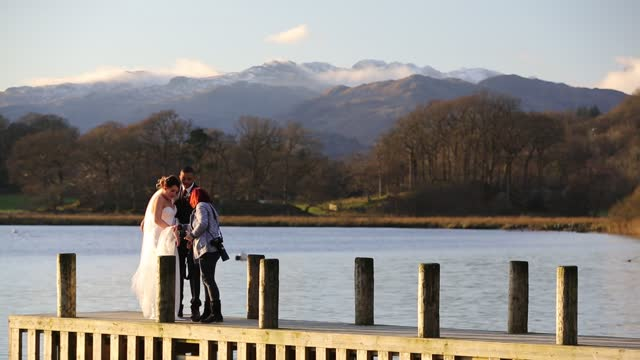 couple having their wedding photographs taken on a public jetty at the head of lake windermere on june 3, 2021 in ambleside, lake district, england. - jetty stock videos & royalty-free footage