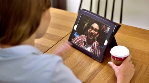 ms couple having video call on digital tablet - boyfriend stock videos & royalty-free footage