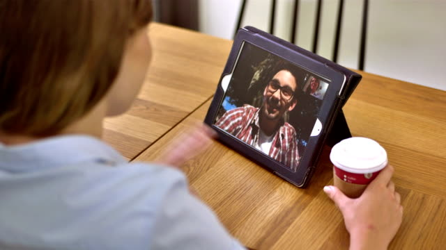 ms couple having video call on digital tablet - boyfriend stock videos & royalty-free footage