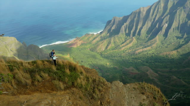 couple hiking in hawaii's na pali coast - hawaii islands stock videos and b-roll footage