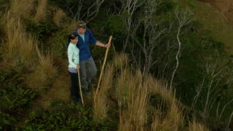 couple hiking in hawaii's na pali coast - kauai stock videos & royalty-free footage