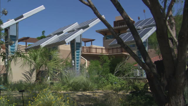 la ws pan couple hiking past solar panels in springs preserve / las vegas, nevada, usa - preserve stock videos and b-roll footage