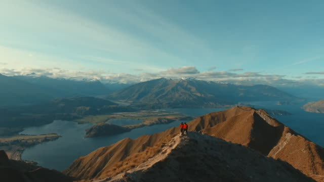 a couple hiking to the top of mountain - two people stock videos & royalty-free footage