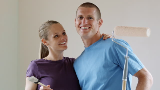 couple holding a paint brush and roller - see other clips from this shoot 1418 stock videos & royalty-free footage