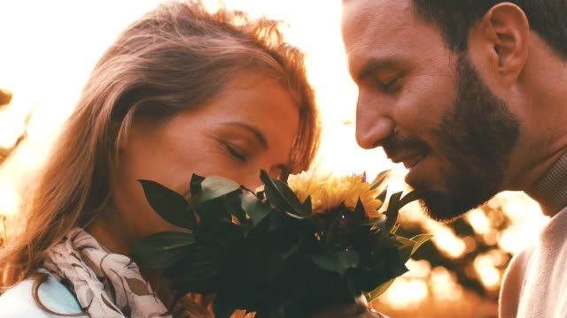 couple holding bouquet of flowers together - mid adult couple stock videos & royalty-free footage