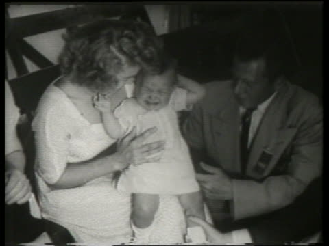 b/w couple holding crying baby / canadian national exhibition / sound - two parents stock videos & royalty-free footage