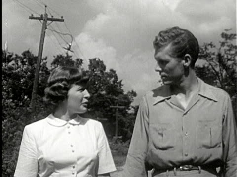 MS, COMPOSITE, HA, DS, B/W, Couple holding hands and talking while walking on rural road, USA