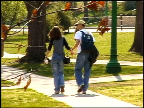 Couple Holding Hands and Walking on Indiana University Campus