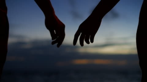 couple holding hands at dusk - flirting stock videos & royalty-free footage