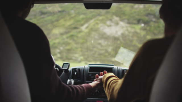 couple holding hands in mini van during vacations - two people stock videos & royalty-free footage