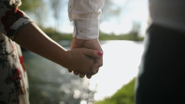 couple holding hands in nature - cufflink stock videos & royalty-free footage