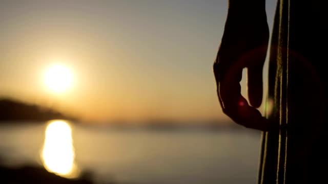 couple holding hands in sunset - rear view stock videos & royalty-free footage