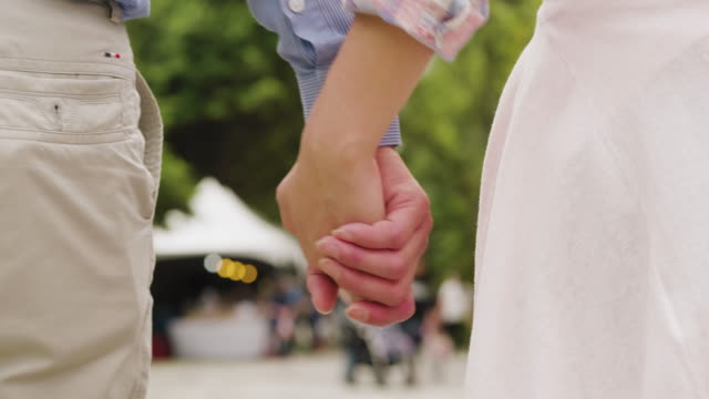 a couple holding hands in the park - taipei stock videos & royalty-free footage
