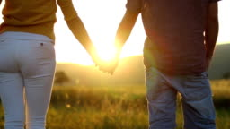 Couple Holding Hands In Wheat Field