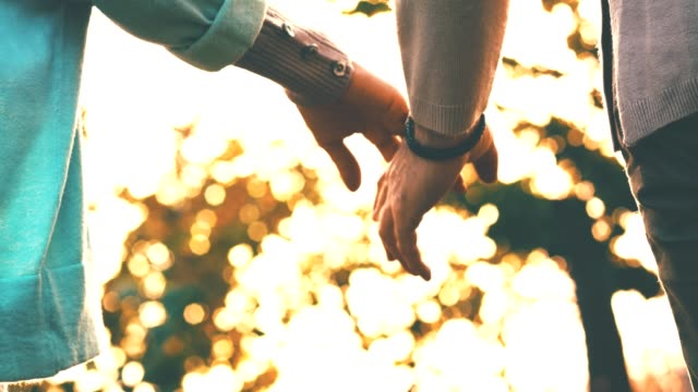 couple holding hands - back lit stock videos & royalty-free footage