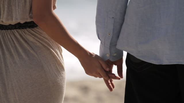 couple holding hands - falling in love stock videos and b-roll footage