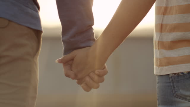 couple holding hands - holding stock videos & royalty-free footage