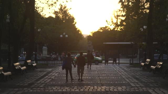 vídeos y material grabado en eventos de stock de couple holds hands and walks towards sunset in santiago - camino santiago