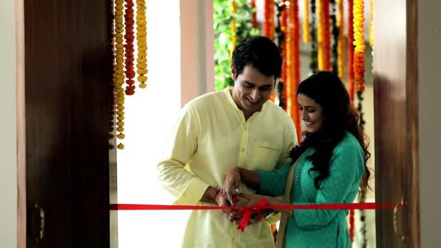 couple house warming, delhi, india - ribbon bow stock videos & royalty-free footage