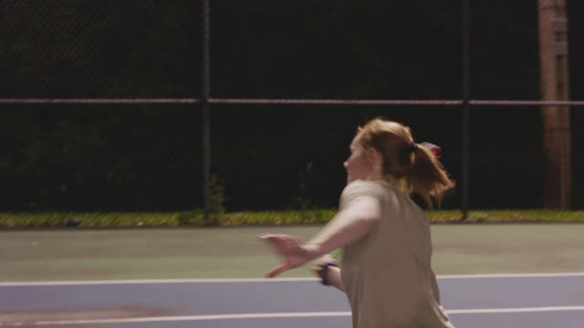 couple hug after tennis match, close up - netting stock videos & royalty-free footage
