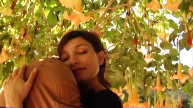 Couple hugging under tree