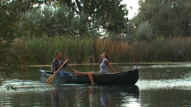 couple in a canoe - see other clips from this shoot 1171 stock videos and b-roll footage