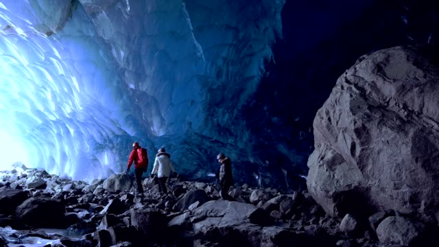 couple in an ancient glacial ice cave - travel stock videos & royalty-free footage
