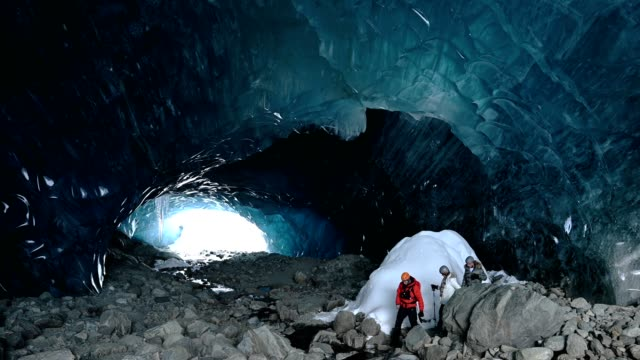 couple in an ancient glacial ice cave - cave stock videos & royalty-free footage