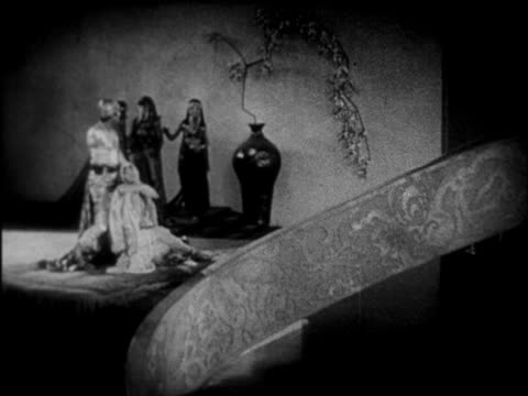 b/w 1924 couple in arabian costume taking off on magic carpet / feature - 1924 stock videos and b-roll footage