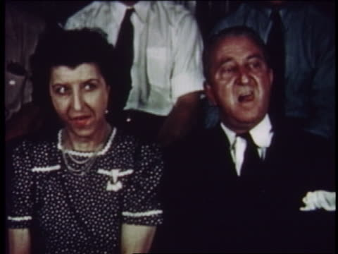 1954 couple in audience moving mouths + nodding - 1954 stock videos & royalty-free footage