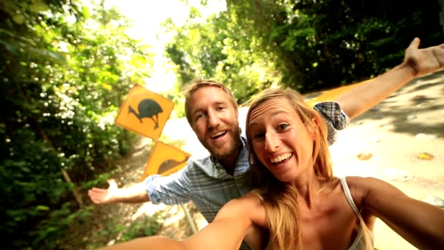 couple in australia take selfie with humorous cassowary road sign - famous place stock videos & royalty-free footage