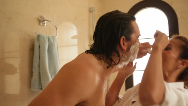 couple in bathroom, man shaving - husband stock videos & royalty-free footage